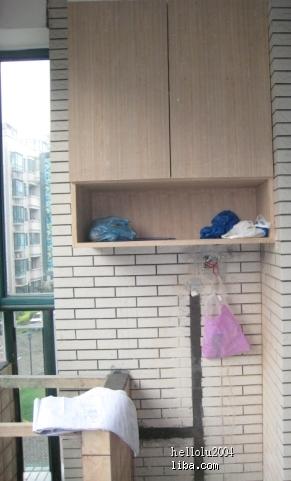 木工做的阳台柜子.门板也是他做的