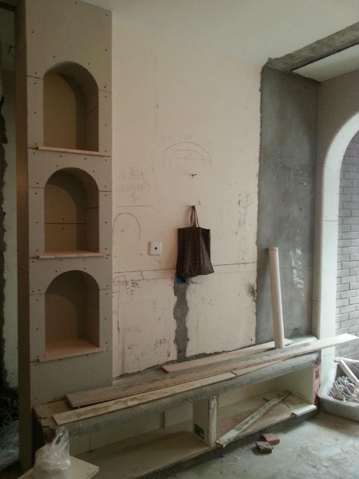 本来就打算做一道立体竖型造型墙,后来想想电视柜也懒得买,直接让木工图片